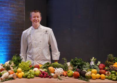 Chef Jason Goddard at Pantry table inside Workshop at Luminary Hotel