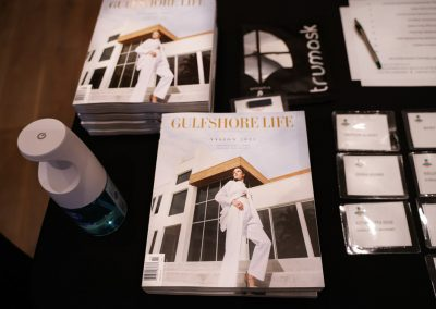 Gulfshore Life mag at VIP registration table outside Luminary Hotel and Co. Workshop