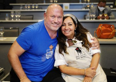 Chefs Harold Balink and Chef Gloria Jordan smile after Showdown